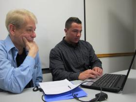 Ronald Pederson (left) of North Versailles gets help signing up for health insurance from Christian Fattore, a certified application counselor with the Consumer Health Coalition.