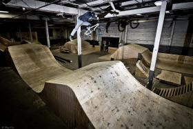 The 80,000 square foot warehouse houses many ramps like this one, where kids and adults can bike.