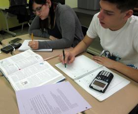 Alex Mosesso and Zach Davies working on physics problems in Marino's class.