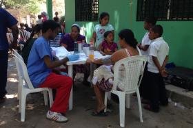 Students working with residents during the medical portion of the brigade