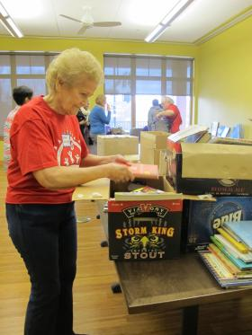 Helen Crowley of Crafton sorts books in the library at East End Cooperative Ministry.