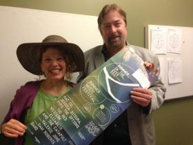 Business Contributor Rebecca Harris and Paul Guggenheimer displaying a poster for WYEP's Summer Music Festival, just one of the many festivals coming to Pittsburgh this summer.