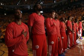 The Los Angeles Clippers protest the racist comments made by their owner by wearing their shooting shirts inside out.