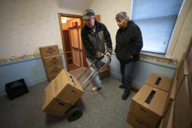 Pastor Lee Dreyer, along with Janet McIntyre, haul boxes full of water jugs out to clients as part of the Water for Woodlands water bank at the White Oak Springs Presbyterian Church in Renfrew, Pa.