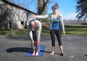 Janna Leyde practices yoga with her father John.