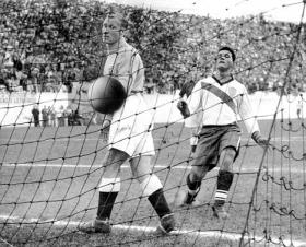 Joe Gaetjens puts Walter Bahr's shot past English goalie Bert Williams to give the U.S. a 1-0 lead on June 29, 1950.