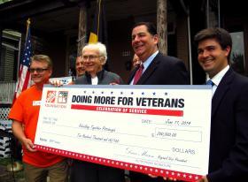 Bob Beachy (far left), John Malloy, Mayor Bill Peduto and City Councilman Corey O'Connor accepting a grant from the Home Depot Foundation.