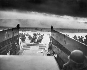 Chief Photographer's Mate Robert F. Sargent took this photograph just as a group of soldiers stepped off a Coast Guard landing craft and headed for the Normandy beaches June 6, 1944.