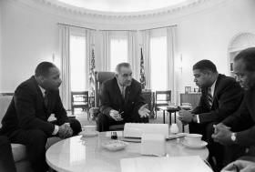 President Lyndon B. Johnson meets with Civil Rights leaders Martin Luther King, Jr., Whitney Young, James Farmer in January 1964. In July of that year he signed the Civil Rights Act into law.