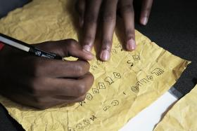 As part of a recent program at The Labs at the Carnegie library's East Liberty branch, teens created their own hieroglyph-inspired coded language.