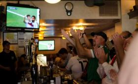 World Cup watching at Pipers Pub on the South Side, soccer fans from the Pittsburgh area celebrate a goal scored by Germany during Monday's match against Portugal.