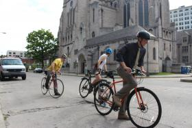 Instructor Dan Yablonsky leads cyclists in East Liberty