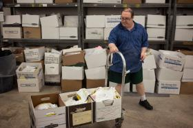 Michael Kissel, 36, transports paper to be shredded at the Westmoreland County Blind Association in Greensburg. Kissel, who has Down syndrome, said he earned $57 on his last biweekly paycheck.