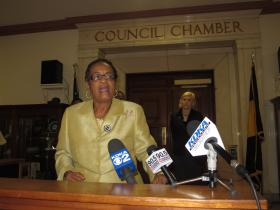 Rev. Dr. Barbara Reynolds of the national activist organization Black Women for Positive Change addresses press and supporters outside City Council chambers Tuesday morning.