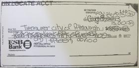 An example of a check returned to the city by the bank because it was illegible.