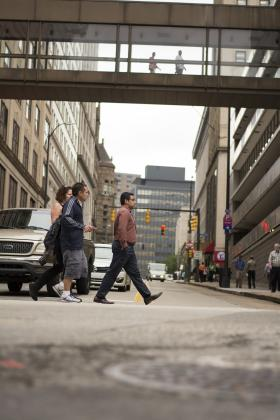Pedestrians cross Forbes Avenue in downtown Pittsburgh Wednesday.
