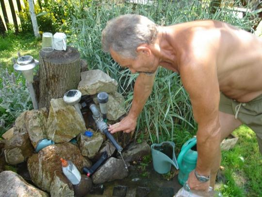 Andrezj Bak worries shale drilling might contaminate his well water.