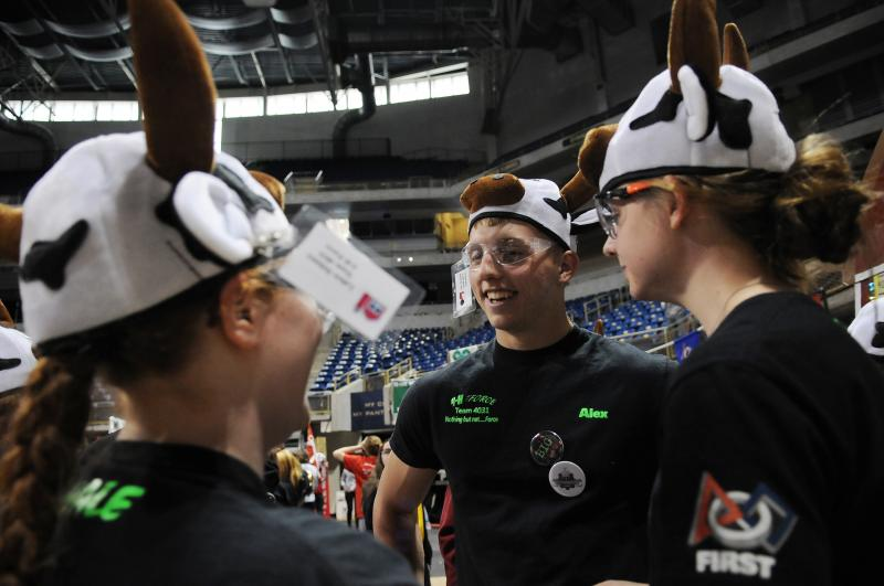 "Laken Delaney, Alex Russell and Katie Russell (left to right), members of the team 4-H Force, wait while their robot ""Bessie"" is inspected by an event official."
