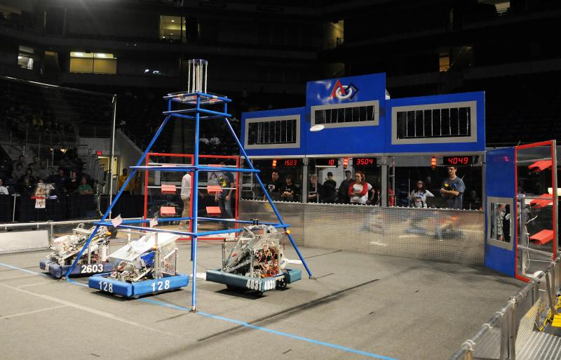 A robot fires a Frisbee into a goal area during a practice run.