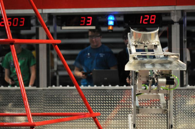 A robot moves about the field during a practice run.
