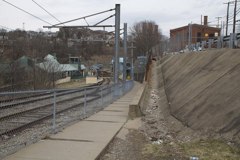 A wheelchair ramp leading from E. Warrington Ave to South Hills Junction