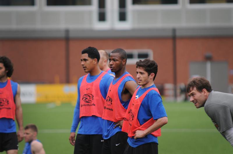 Team members look on during a practice session Thursday at Highmark Stadium.