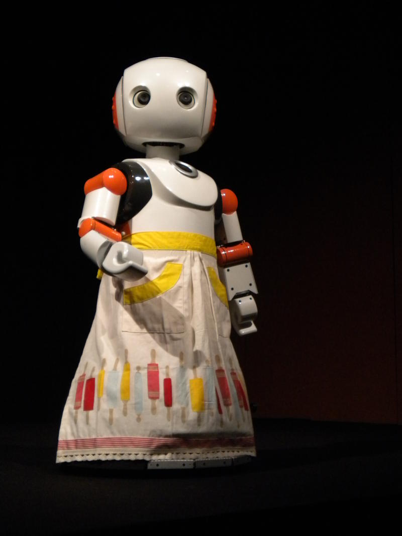 A robot in I, Worker is humanized further with a feminine apron, these robots have human qualities, but not too human.