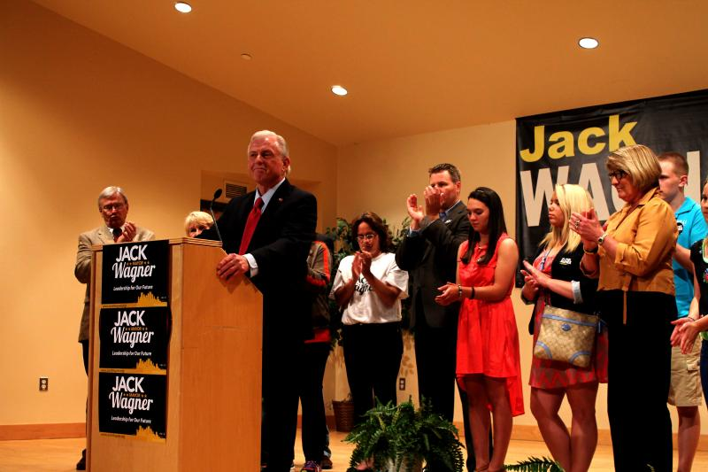Friends and family of Jack Wagner surround him as his supporters applaud the mayoral candidate.