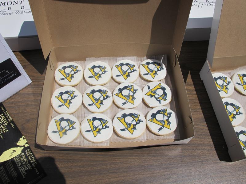 The rally had a carnival-like atmosphere with games, prizes and Penguins-themed cookies, among other things.