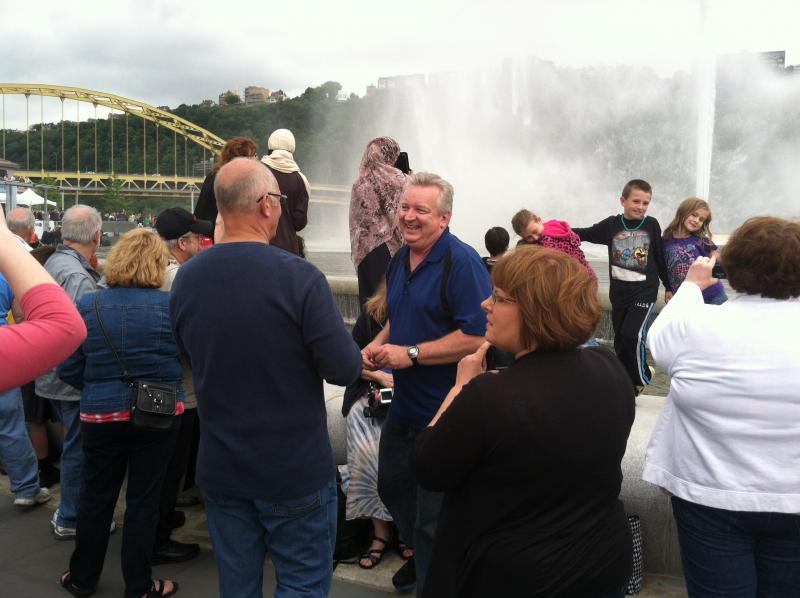People celebrating the return of the fountain at Point State Park