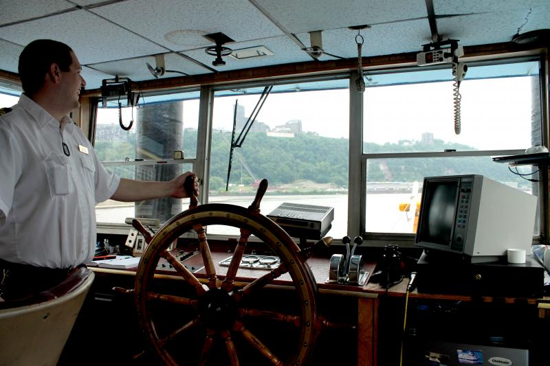 Capt. Jason Jones steers The Duchess down the Ohio River during a sightseeing tour.
