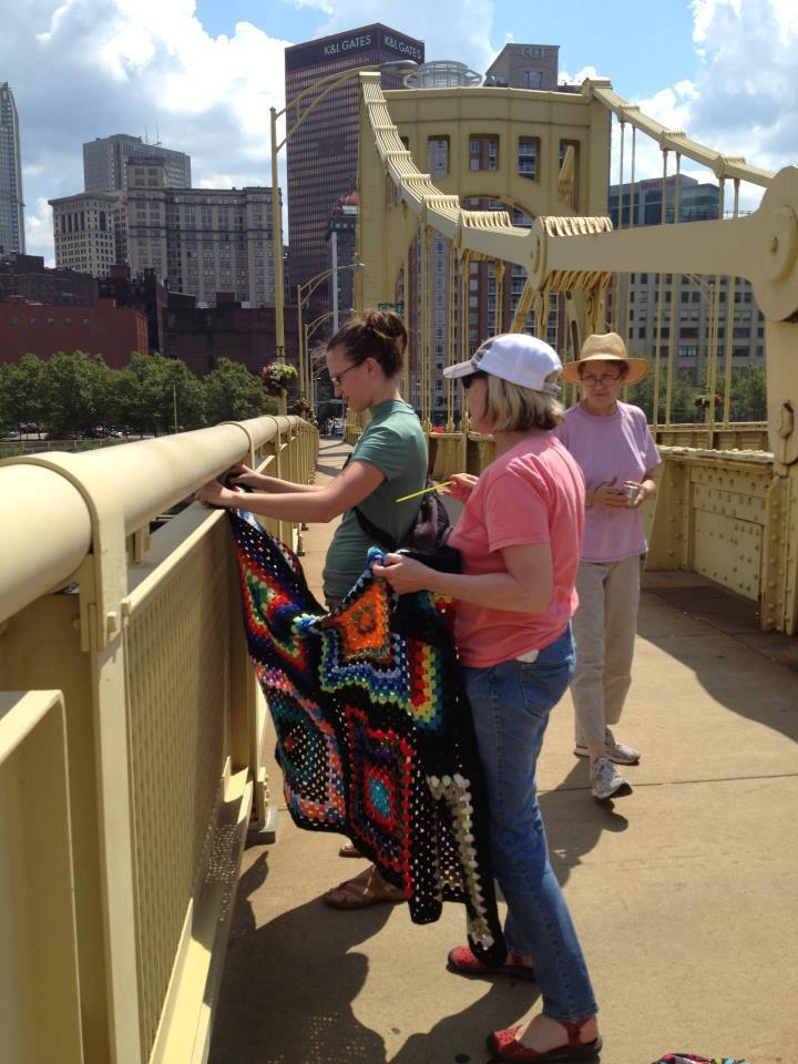 As part of Knit the Bridge, the Andy Warhol Bridge's towers will be covered in 2,500 linear feet of brightly colored panels, the rails will be covered with black yarn and the panels inside the rails will consist of designs created by volunteers.