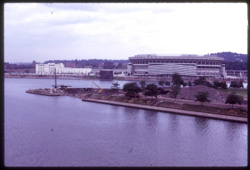 This 1970s photograph shows Three Rivers Stadium and the construction site of the Point State Park fountain after the demolition of the Manchester and Point bridges.