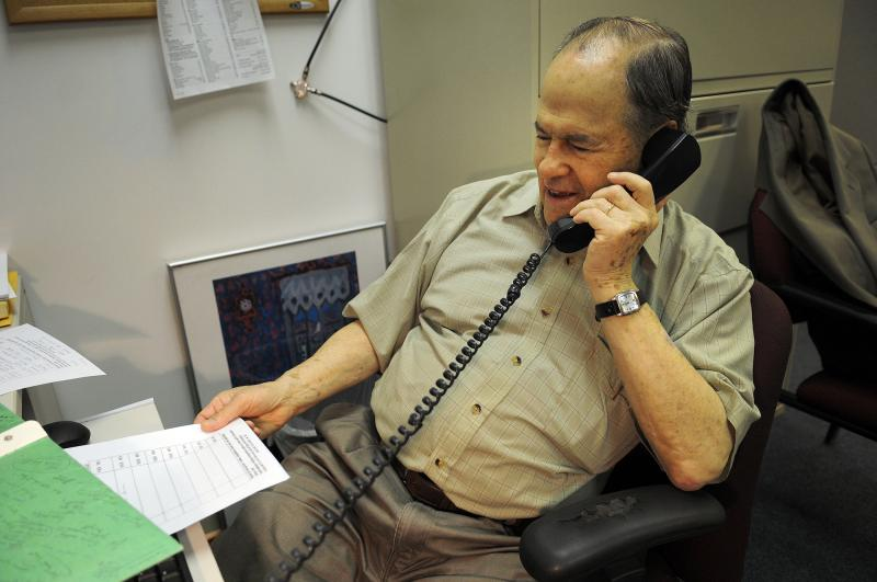 Joe Finkelpearl, 81, makes a call to a fellow senior as part of the Agewell Pittsburgh program.