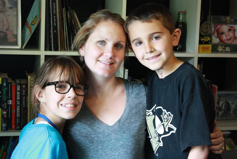 Caden Lott, 7, and Lexy Lott, 11, with their mother Nicole.