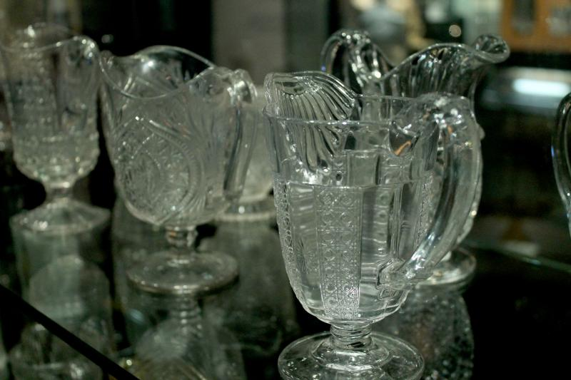 """Glass: Shattering Notions"" features a display of nearly 150 creamer pitchers that were made from the process of pressing glass. Pressed glass was a technique adopted by Pittsburgh glass makers that helped them find success in the industry."