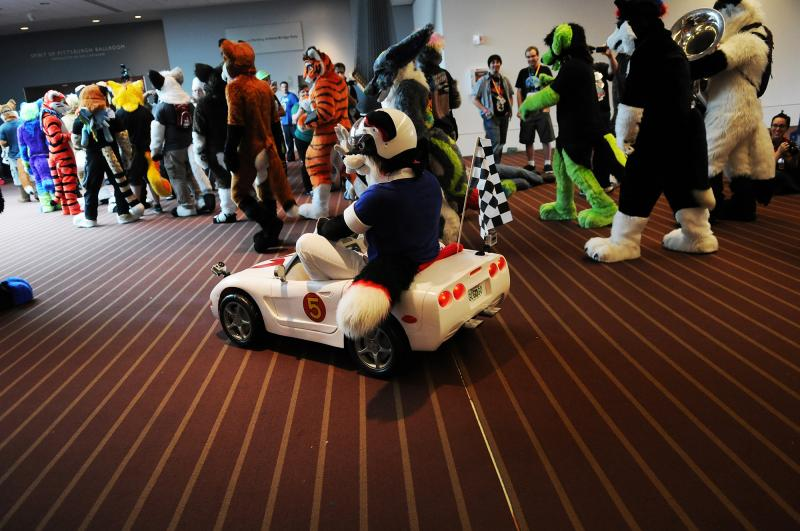 A fursuit parade winds its way through the David L. Lawrence Convention Center Saturday.