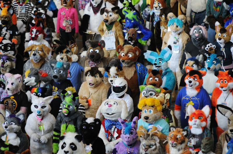Furries gather for a photo op Saturday at the David L. Lawrence Convention Center in Pittsburgh as part of Anthrocon, which organizers bill as the world's largest convention for those fascinated with animal characters.