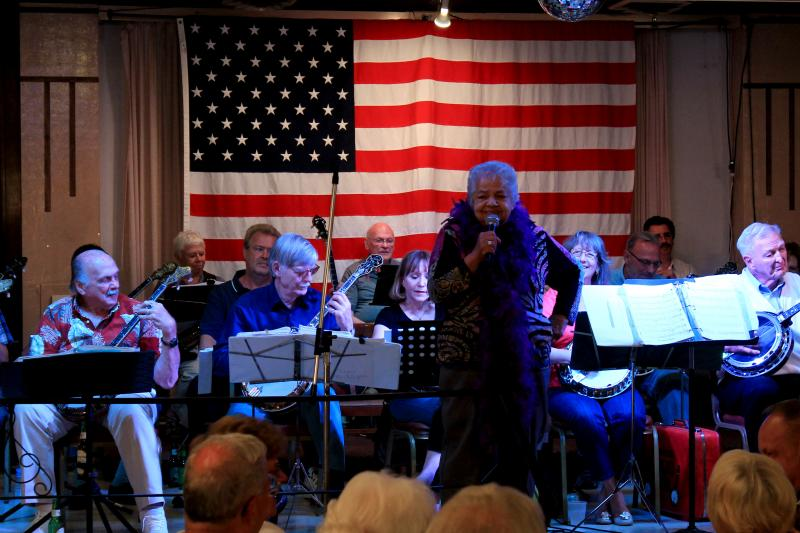 DJ Devine, a vocalist with the banjo club, puts on a show for the audience at the Elks Lodge.