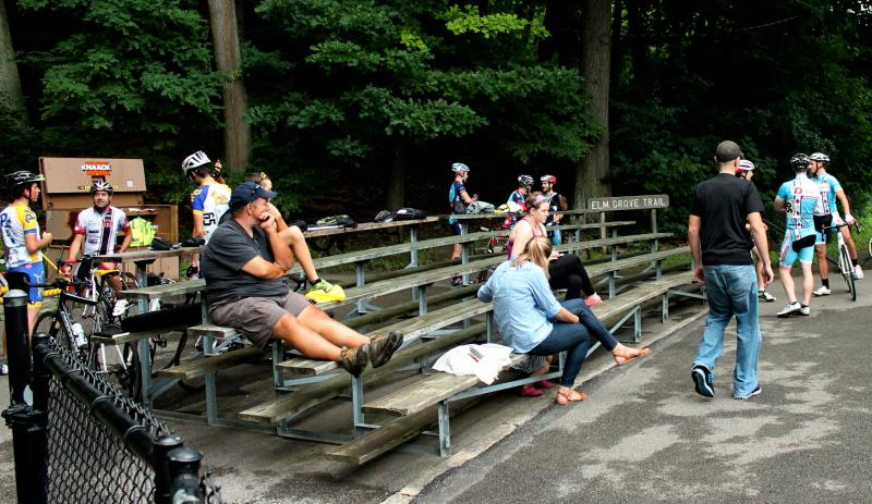 Spectators and riders for the next race wait to see who takes home the first place prize.