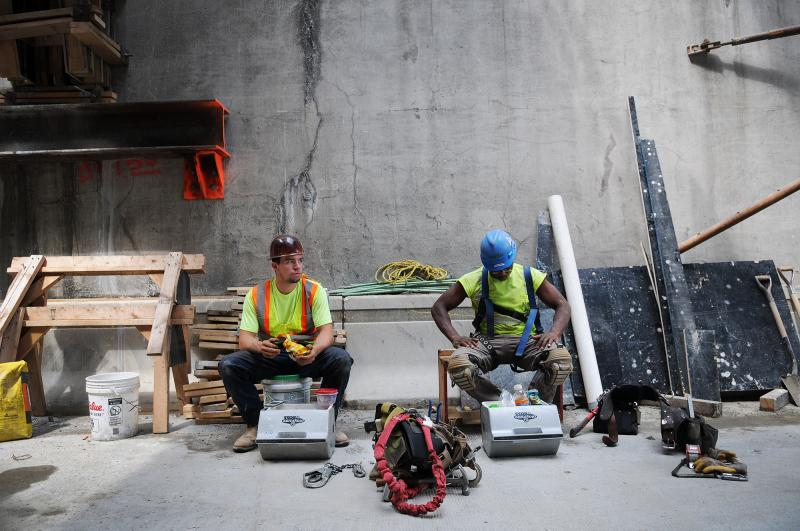 Carpenters Tyler Fleming (left) and Kevin Jones pause for a lunch break on the north end of the inbound Liberty Tunnel.