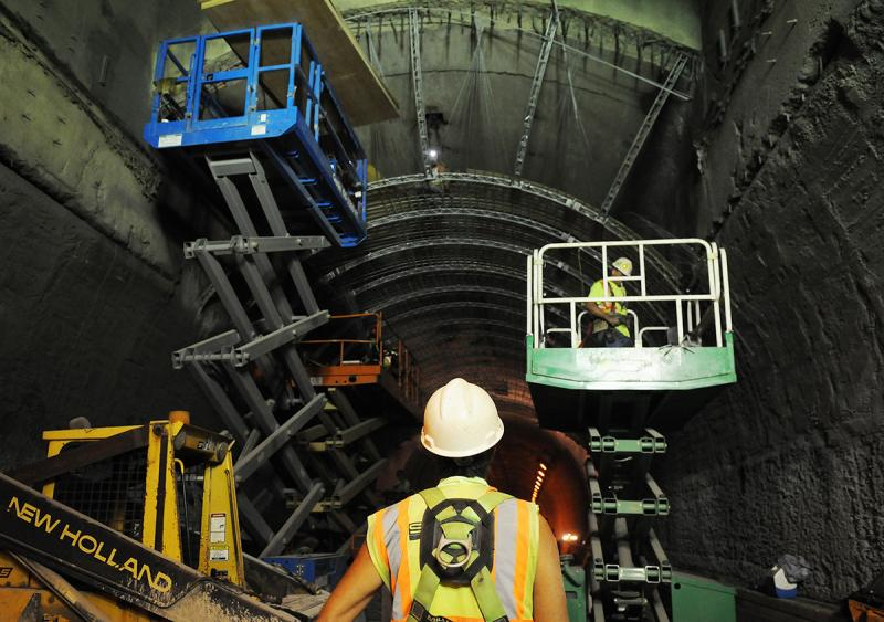 A worker looks north down the inbound Liberty Tunnel as crews work on the ventilation arch wall.