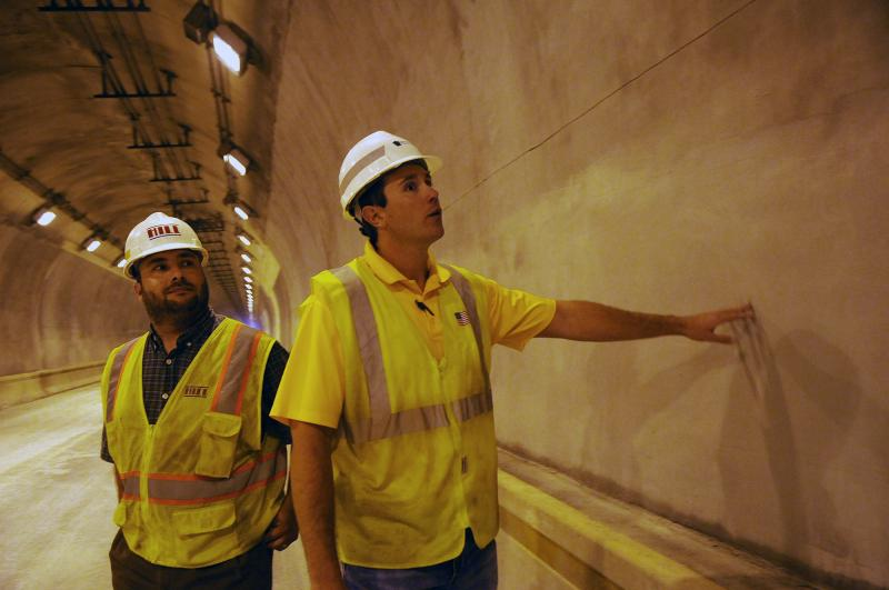 Construction project manager Danny Rosensteel (left) and Heath Butler, an assistant construction engineer for PennDOT, inspect the walls of the inbound tunnel on Aug. 22.