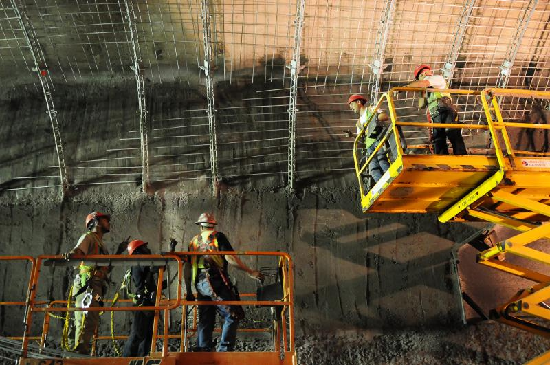 "Workers install reinforcement to finish the the ventilation arch wall, or ""nozzle wall,"" a concrete arch that provides for air flow as part of the tunnel's ventilation system."