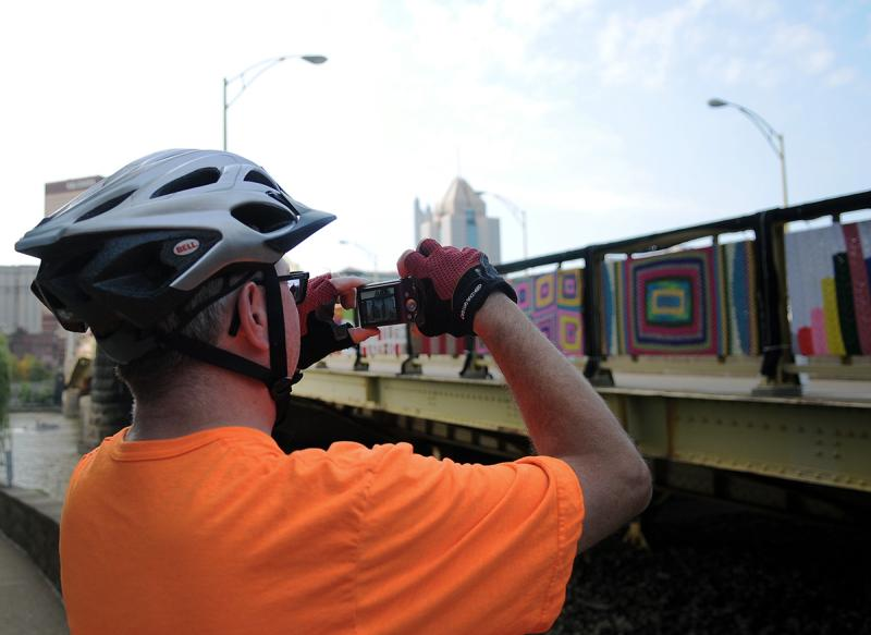 Joel Woller pauses to snap a photo of the bridge on Sunday.