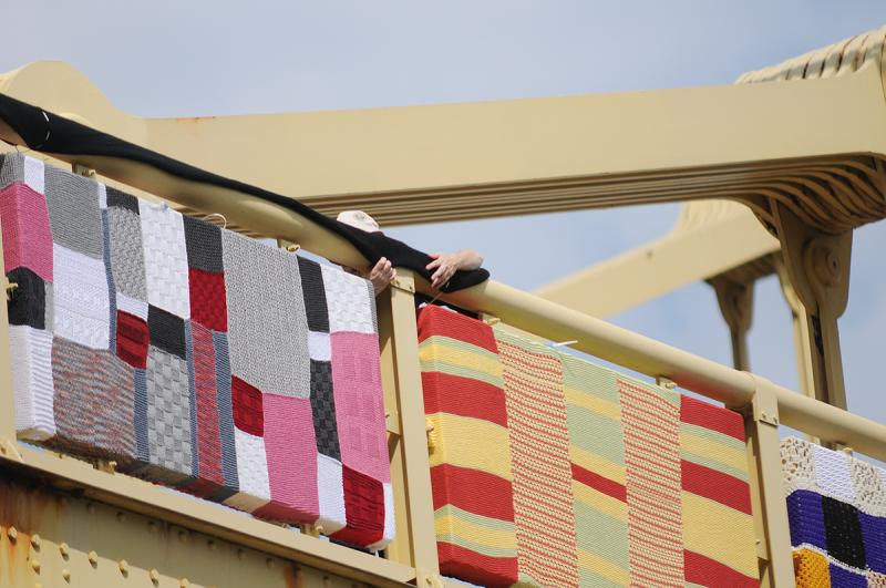 A panel is installed on the Andy Warhol Bridge Saturday morning.