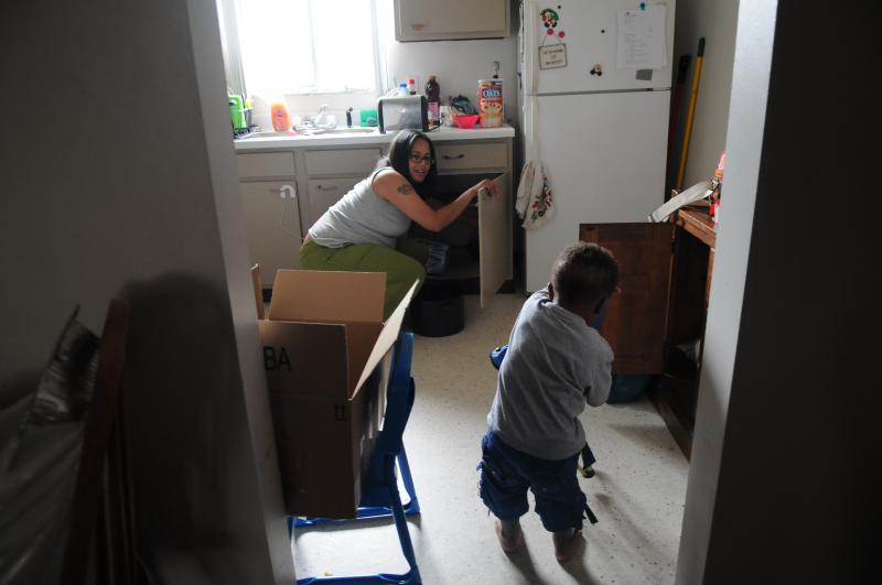 Rachel Zwipf boxes up things in her kitchen while keeping an eye on her son Jackson. Two summers ago, Zwipf's fiancé was murdered in Lawrenceville. She and her son recently moved to North Carolina, leaving behind painful memories of Pittsburgh.
