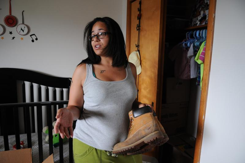 Zwipf pulls a pair of boots that belonged to her fiancé out of Jackson's closet.