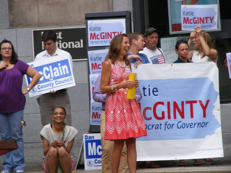 Kathleen McGinty, former Secretary of the state DEP, and her supporters greet the marchers as they turn onto Grant Street.