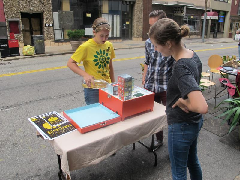 Volunteers with GTECH demonstrate how parks can mitigate overflow of water.